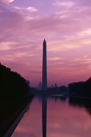 Washington Monument mirrored in the Reflecting Pool at twilight. by Ira Block