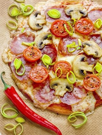 Pizza with Salami, Mushrooms, Tomatoes, Leek, Mozzarella and Chillis by Ira Leoni