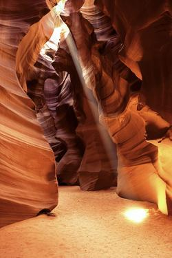 A Beam of Sunlight Shining into the Antelope Canyon Slot Canyon by Ira Meyer