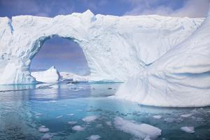A Huge Arch in an Iceberg Off the Coast of Pleneau Island by Ira Meyer
