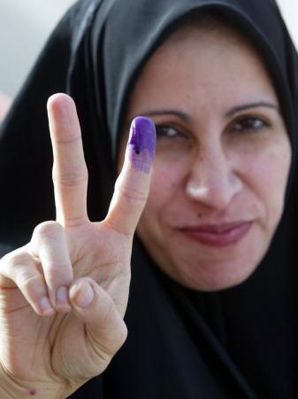 https://imgc.allpostersimages.com/img/posters/iraqi-woman-holds-up-her-purple-finger-indicating-she-has-just-voted-in-southern-iraq_u-L-Q10ONSI0.jpg?artPerspective=n