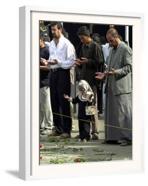 Iraqis, Inluding a Little Girl, Pause to Pray