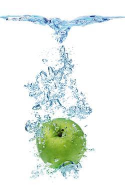 Green Apple In Water by Irochka