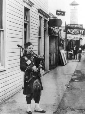Scottish Bagpiper by Irving Underhill