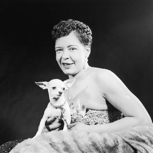 Famed Jazz Singer Billie Holiday with Her Pet Chihuahua,1957 by Isaac Sutton