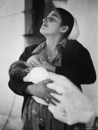 https://imgc.allpostersimages.com/img/posters/israeli-mother-breast-feeding-her-baby_u-L-P3M37Y0.jpg?artPerspective=n