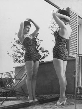 Italian Actress Gina Lollobrigida Admiring Reflection of Herself Wearing Bathing Suit in Mirror