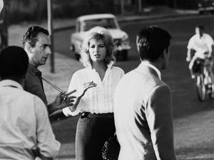 Italian director Michelangelo Antonioni (1912 - 2007) on the set of the film L'eclisse with Monica
