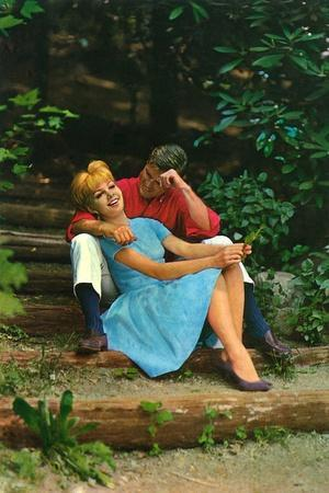 Couple in love sitting in a park, 1960s