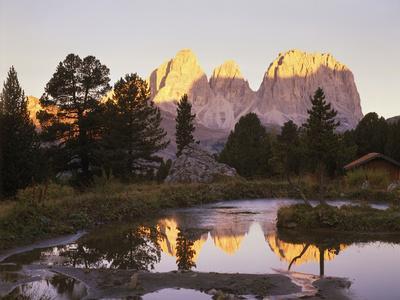 https://imgc.allpostersimages.com/img/posters/italy-south-tyrol-dolomites-langkofel-sella-pordoijoch-lake-morning-mood_u-L-Q11YRPO0.jpg?p=0