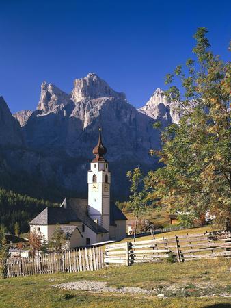 https://imgc.allpostersimages.com/img/posters/italy-south-tyrol-gr-nertal-dolomites-kolfuschg-sella-church-autumn_u-L-Q11YUU70.jpg?p=0