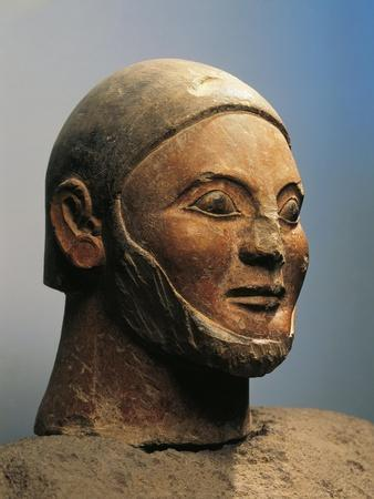 https://imgc.allpostersimages.com/img/posters/italy-tuscany-chiusi-detail-of-funerary-statue-in-the-shape-of-a-canopic-vase_u-L-POPV7D0.jpg?artPerspective=n