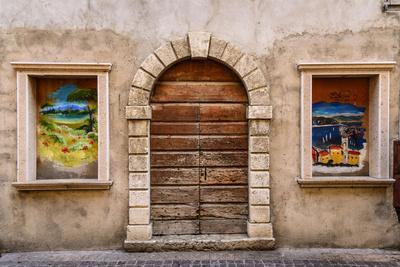 https://imgc.allpostersimages.com/img/posters/italy-veneto-lake-garda-torri-del-benaco-old-town_u-L-Q11YUD30.jpg?artPerspective=n