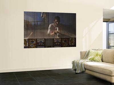 Carpet Weaver by Izzet Keribar