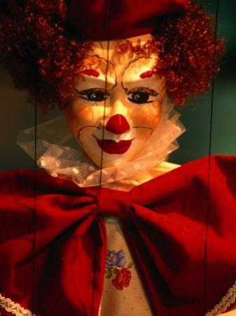 Clown-Faced Marionette in a Shop, Athens, Attica, Greece by Izzet Keribar