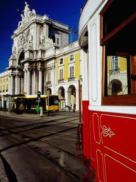 Tram on Praca De Commercio, Lisbon, Portugal by Izzet Keribar