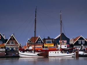 Waterfront Houses and Boats, Volendam, Netherlands by Izzet Keribar