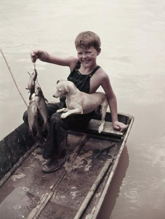 A Boy Proudly Displays His Catch of Spotted Channel Catfish