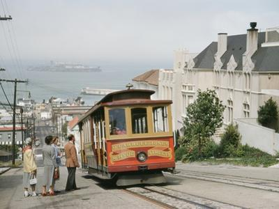 A Cable Car Stops to Pick Up Passengers on Hyde Street