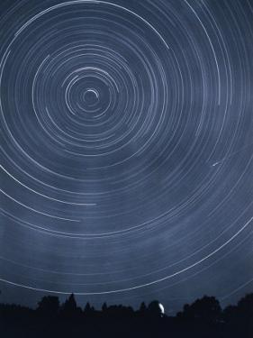 A Time-Exposure Creates Circular Star Tracks Around Polaris by J. Baylor Roberts