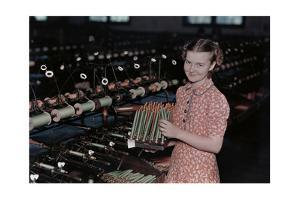 A Young Girl Removes Raw Fiber from Spools to Spindles for Weaving by J. Baylor Roberts
