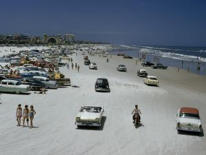 Cars, Motorbikes, and Bathers Share One Strip of Sand in 1957 by J. Baylor Roberts