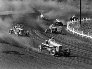 Race Cars Roar around the Track at the Iowa State Fair in 1938 by J. Baylor Roberts