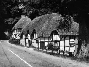 Deep Thatched Cottages at  Wherwell, Hampshire, England by J. Chettlburgh