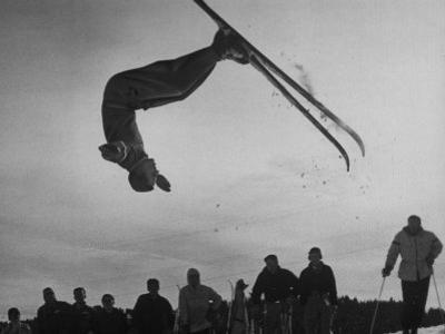 Acrobatic Skier Jack Reddish in Somersault at Sun Valley Ski Resort by J. R. Eyerman
