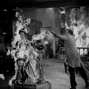 """Actor Vincent Price Putting Out Fire in Film """"House of Wax"""" by J. R. Eyerman"""