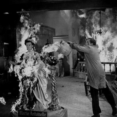 "Actor Vincent Price Putting Out Fire in Film ""House of Wax"" by J. R. Eyerman"