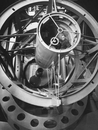 Astronomer Edwin Hubble Pictured Inside the Workings of the Huge 200 In. Mt. Palomar Telescope by J. R. Eyerman