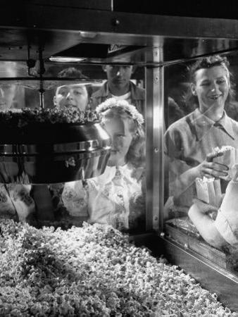 Children Watching a Popcorn Working by J. R. Eyerman
