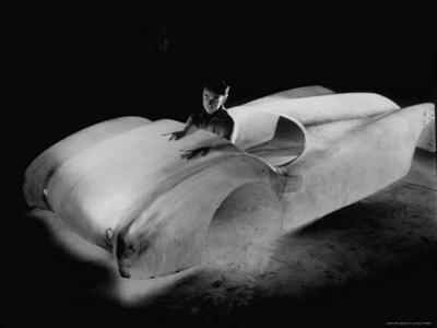 Designer Bill Tritt Inspecting the First Production Model Body of His Plastic Car by J. R. Eyerman