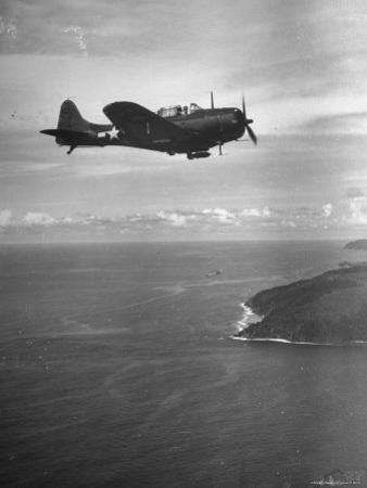 F-6 Hellcat Fighter Plane over Tanahmera Bay as Japanese Airfields at Hollandia, New Guinea by J. R. Eyerman