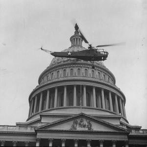First Successful Us Army Helicopter Designed by Igor Sikorsky Flying Past the Capitol Dome by J. R. Eyerman