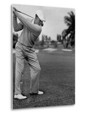 Golfer Ben Hogan, Keeping His Shoulders Level at Top of Swing by J. R. Eyerman