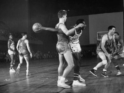 Harlem Globetrotters Playing a Basketball Game by J. R. Eyerman