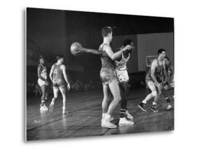 Harlem Globetrotters Playing a Basketball Game by J. R. Eyerman