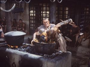 "Kirk Douglas Dunking Enemy's Head in Giant Cook Pot in Scene From Stanley Kubrick's ""Spartacus"" by J. R. Eyerman"