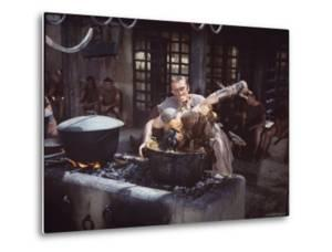 "Kirk Douglas Dunking Enemy's Head in Giant Cook Pot in Scene From Stanley Kubrick's ""Spartacus"" by J. R. Eyerman"