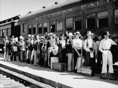 Mexican Farm Workers Boarding Train to Be Taken to Work on Us Farms by J. R. Eyerman