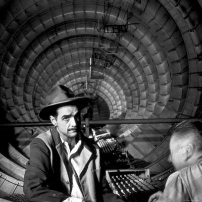 Millionaire Howard Hughes in Cockpit of Huge Sea Plane, Spruce Goose, Which He Designed and Built by J. R. Eyerman