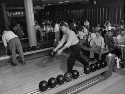 People Bowling at the Mcculloch Motors Recreation Building by J. R. Eyerman