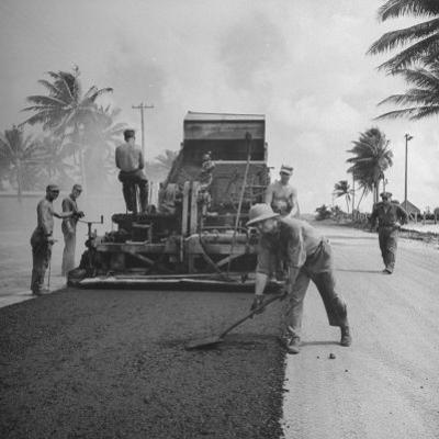 US Navy Seabees Spreading Asphalt During Creation of Air Base by J. R. Eyerman