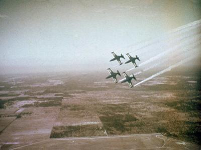 US Navy Stunt Pilots of the Blue Angels Flying their F9F Jets During an Air Show by J. R. Eyerman