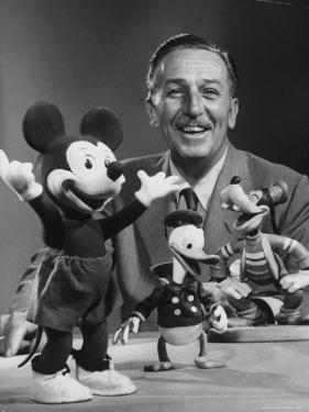Walt Disney, of Walt Disney Studios, Posing with Some Famous Cartoon Characters by J. R. Eyerman