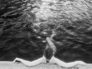 Woman Relaxing in Swimming Pool by Jack Affleck