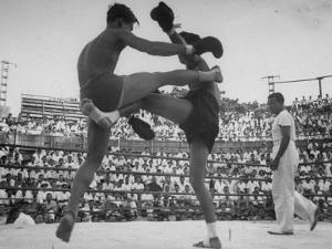Arann Reongchai and Prasong Chaimeeboon Beginning a Match of a Muay Thai Boxinig by Jack Birns