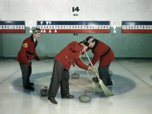 Red-Blazered Men Sweep Brooms on an Ice Rink in a Game of Curling by Jack Fletcher